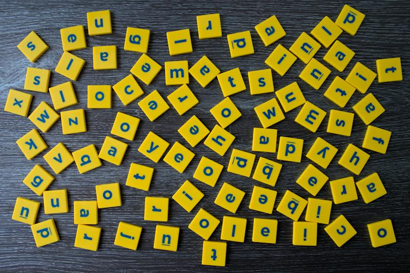 Blocks of English letters scattered. English alphabet letters spread out. Concept of confusion or difficulty in learning as in dyslexia.