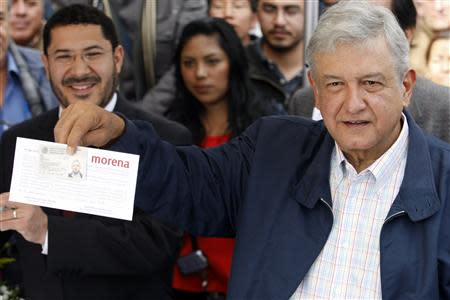 Andres Manuel Lopez Obrador, president of the National Regeneration Movement's (MORENA) National Council, shows his registration form after kicking off MORENA's membership drive in Mexico City's Zocalo in this January 8, 2013 file photo. REUTERS/Bernardo Montoya/Files