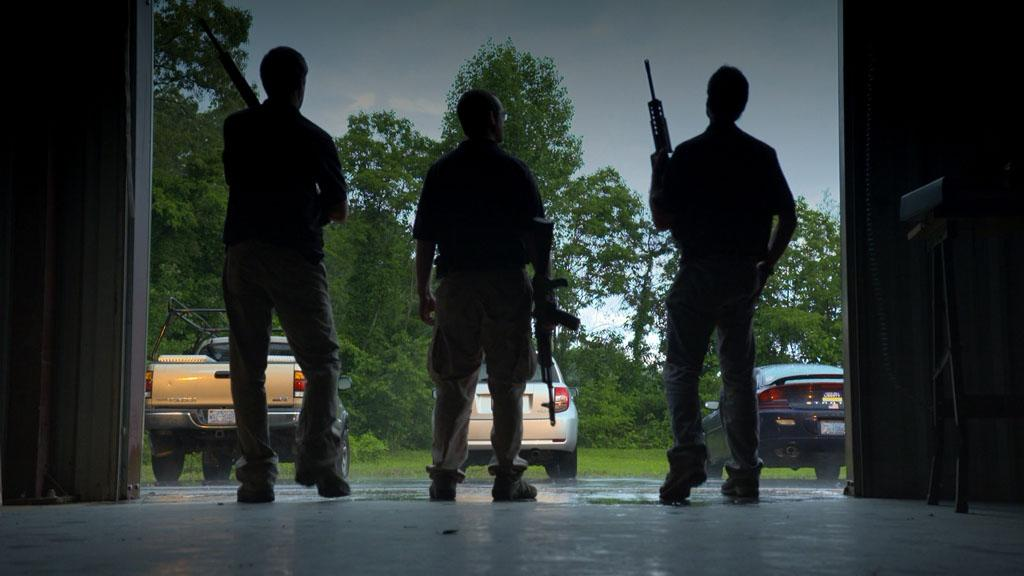 Asheville, NC - Ryan Croft and some of his fellow prepper friends get ready for target practice.
