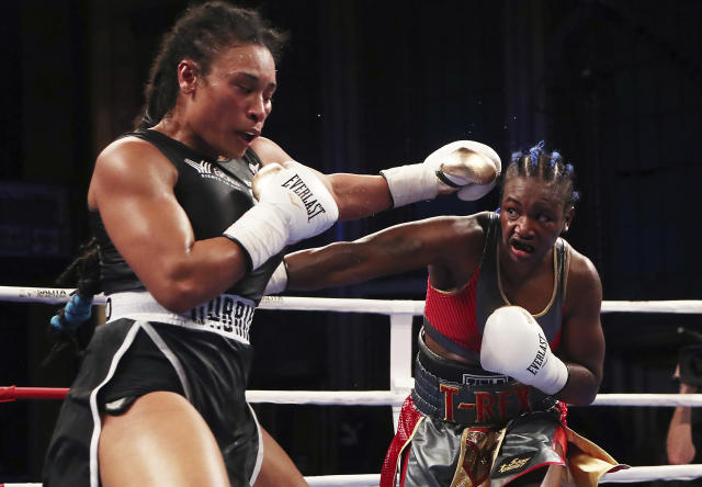 FILE - In this June 23, 2018, file photo, Claressa Shields, right, throws a punch at Hanna Gabriels, of Costa Rica, during the 10th round of their IBF and WBA women's middleweight championship boxing bout in Detroit. Shields faces Christina Hammer for the undisputed middleweight championship on April 13. (AP Photo/Carlos Osorio, File)