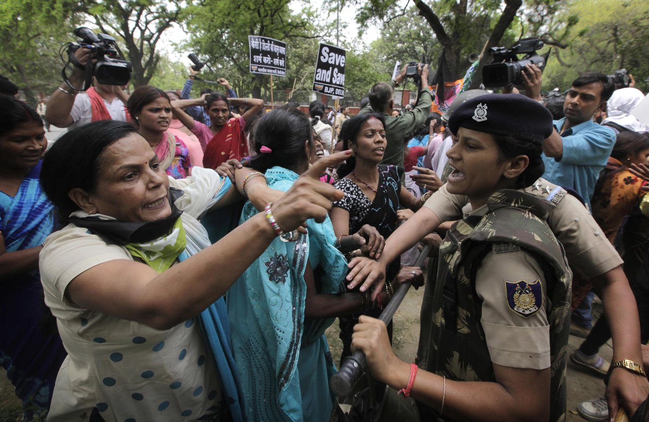 Women activists of India's main opposition Bharatiya Janata Party are stopped by police near the residence of ruling Congress party president Sonia Gandhi during a protest against the rape of a 5-year-old girl in New Delhi, India, Sunday, April 21, 2013. The girl was allegedly kidnapped, raped and tortured by a man and then left alone in a locked room in India's capital for two days. (AP Photo/Manish Swarup)