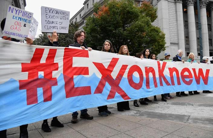 Climate activists protest on the first day of the Exxon Mobil trial outside the New York state supreme court in October 2019.