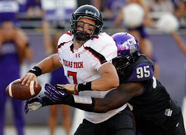 FORT WORTH, TX - OCTOBER 20: Seth Doege #7 of the Texas Tech Red Raiders is sacked for a loss by Devonte Fields #95 of the TCU Horned Frogs at Amon G. Carter Stadium on October 20, 2012 in Fort Worth, Texas. The Texas Tech Red Raiders went on the beat the TCU Horned Frogs 56-53 in triple overtime. (Photo by Tom Pennington/Getty Images)