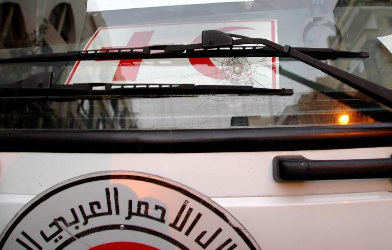 A handout picture released by the official Syrian Arab News Agency on February 8, 2014, allegedly shows a bullet impact on a Syrian Red Crescent vehicle