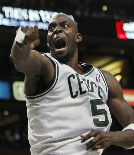 Boston Celtics' Kevin Garnett reacts after making a basket in the first quarter of Game 4 of an NBA basketball first-round playoff series against the Atlanta Hawks, in Boston on Sunday, May 6, 2012. (AP Photo/Michael Dwyer)