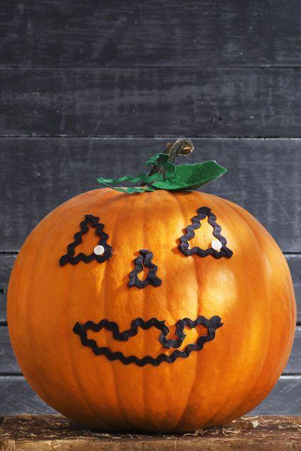 <p>Consider this the easiest Jack-o'-lantern you'll ever make: Just hot-glue black rickrack onto your pumpkin in the shape of a mouth, nose, and eyes. </p>