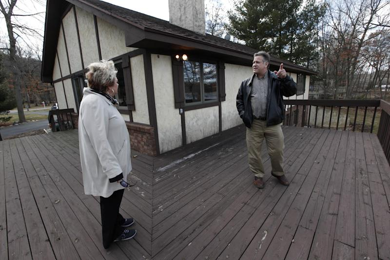 In this Tuesday, April 2, 2013, phogto,  Sam and Liz Weidner, of Hudsonville, Mich., view a home for sale in Cascade Township, Mich. A survey shows U.S. home prices rose 10.5 percent in March compared with a year ago, the biggest gain since March 2006. Core Logic, a real estate data provider, said annual home prices have now increased for 13 straight months. Prices are rising in part because more buyers are bidding on a limited supply of homes for sale.. (AP Photo/Paul Sancya)