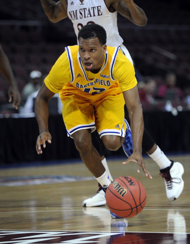Cal State Bakersfield's Issiah Grayson (12) brings the ball up court during the first half of an NCAA college basketball game against New Mexico State in the semifinals of the West Athletic Conference men's tournament Friday, March 14, 2014, in Las Vegas. (AP Photo/David Becker)