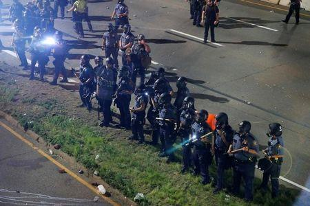 Police are seen as people gather on Interstate 94 to protest the fatal shooting of Philando Castile by Minneapolis area police during a traffic stop, in St. Paul, Minnesota, U.S., July 10, 2016. REUTERS/Adam Bettcher