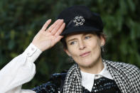 """FILE In this Tuesday, Jan. 23, 2018 file photo, model Stella Tennant poses during a photocall before Chanel Haute Couture Spring-Summer 2018 fashion collection presented in Paris. Tennant, the aristocratic British model who was a muse to designers including Karl Lagerfeld and Gianni Versace, has died suddenly at the age of 50, her family said Wednesday, Dec. 23, 2020. The family asked for their privacy to be respected and said Tennant was """"a wonderful woman and an inspiration to us all."""" Police Scotland said there were no suspicious circumstances. (AP Photo/Christophe Ena, File)"""