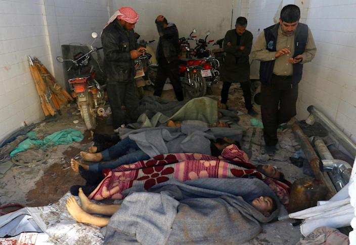<p>Men stand near dead bodies, after what rescue workers described as a suspected gas attack in the town of Khan Sheikhoun in rebel-held Idlib, Syria April 4, 2017. (REUTERS/Ammar Abdullah) </p>