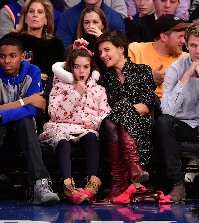 NEW YORK, NY - DECEMBER 16: Suri Cruise and Katie Holmes attend the Oklahoma City Thunder Vs New York Knicks game at Madison Square Garden on December 16, 2017 in New York City. (Photo by James Devaney/Getty Images)