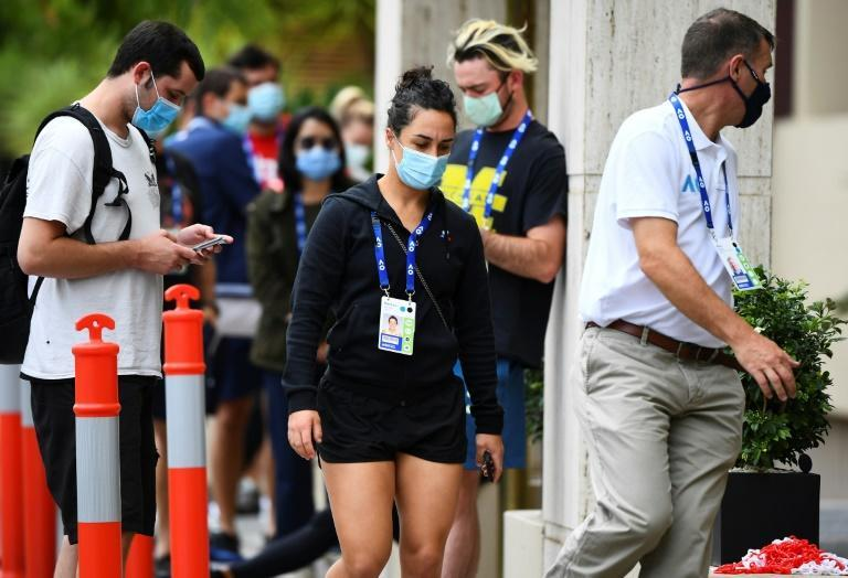 Tennis player Martina Trevisan of Italy (centre) is led into a hotel for a Covid-19 test in Melbourne on Thursday