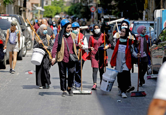 Image: Volunteers set out to clean Beirut's devastated Gemmayzeh neighborhood on Tuesday. (Joseph Eid / AFP - Getty Images)