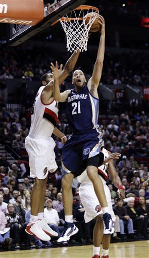 Memphis Grizzlies forward Tayshaun Prince (21) goes to the basket against Portland Trail Blazers forward Nicolas Batum, of France, during the first quarter of an NBA basketball game in Portland, Ore., Tuesday, March 12, 2013. (AP Photo/Don Ryan)