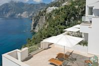 """Unlike the grande dames of the <a href=""""https://www.cntraveler.com/story/gold-list-hotels-amalfi-coast?mbid=synd_yahoo_rss"""" rel=""""nofollow noopener"""" target=""""_blank"""" data-ylk=""""slk:Amalfi Coast,"""" class=""""link rapid-noclick-resp"""">Amalfi Coast,</a> Angelina is sleek, modern, and a startling, almost Greek-style interloper to the cliffside above pretty Praiano. All 42 rooms are white-on-white, accented by views of the bright blue sea below from their private terraces; if you want to be more at one with nature, go for the Eaudesea Experience rooms—whitewashed old fishermen's cottages, etched into the cliffside above La Gavitella beach, below the hotel (be warned, though—there are 200 steps plus an elevator up to the main building). Down on said beach is a club for all hotel guests; if you can't face the climb, there are indoor and outdoor pools on the main property. The house boat, meanwhile, will swivel you around the coast, and even over to Capri. Back on site, Un Piano nel Cielo (A Floor in the Sky) takes just-netted fish to new heights (literally—it's the rooftop restaurant), while Seascape Cocktail Bar, cantilevered over the bay, does a fine line in limoncello-infused mojitos. Note that children under 12 are not permitted."""