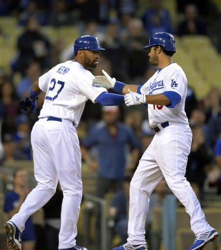 Los Angeles Dodgers' Matt Kemp, left, congratulates Los Angeles Dodgers' Andre Ethier after he hit a two-run home run during the first inning of their baseball game against the Washington Nationals, Friday, April 27, 2012, in Los Angeles. (AP Photo/Mark J. Terrill)