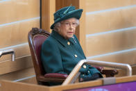 Britain's Queen Elizabeth II sits in the debating chamber to mark the official start of the sixth session of the Scottish Parliament, in Edinburgh, Scotland, Saturday, Oct. 2, 2021. (Jane Barlow/Pool Photo via AP)