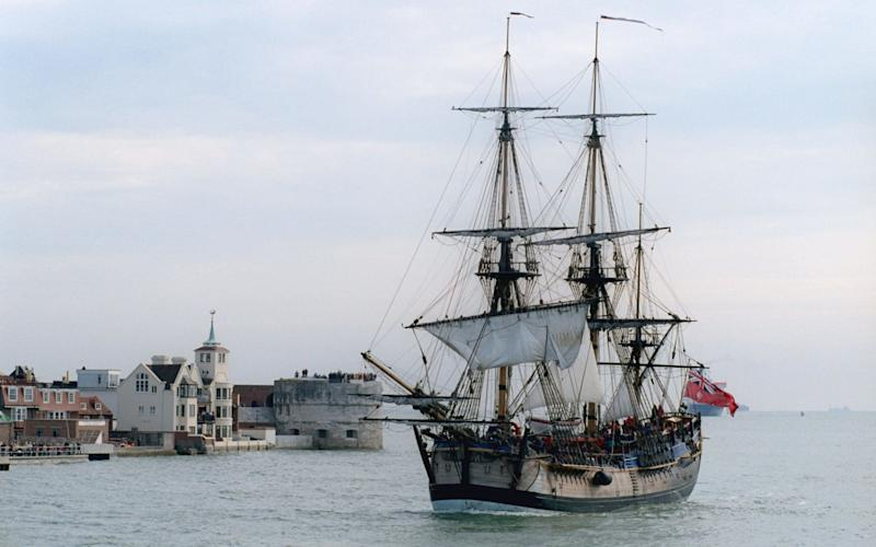 Replica of Captain Cook's 'Endeavour' receives a ceremonial escort as it sails into Portsmouth harbour,