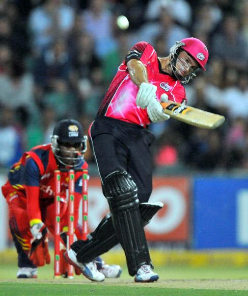 Michael Lumb of the Sixers hits a six during the Karbonn Smart CLT20 Final match between bizhub Highveld Lions and Sydney Sixers at Bidvest Wanderers Stadium on October 28, 2012 in Johannesburg, South Africa. (Photo by Duif du Toit/Gallo Images/Getty Images)