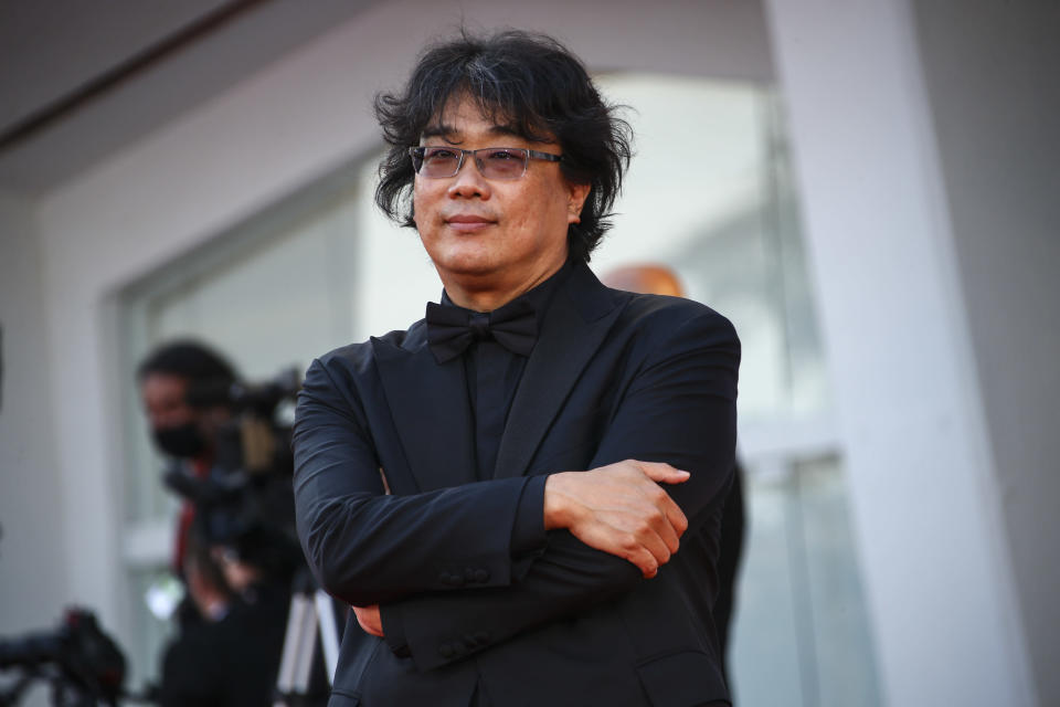 Bong Joon-ho poses for photographers upon arrival at the closing ceremony of the 78th edition of the Venice Film Festival in Venice, Italy, Saturday, Sept. 11, 2021. (Photo by Joel C Ryan/Invision/AP)