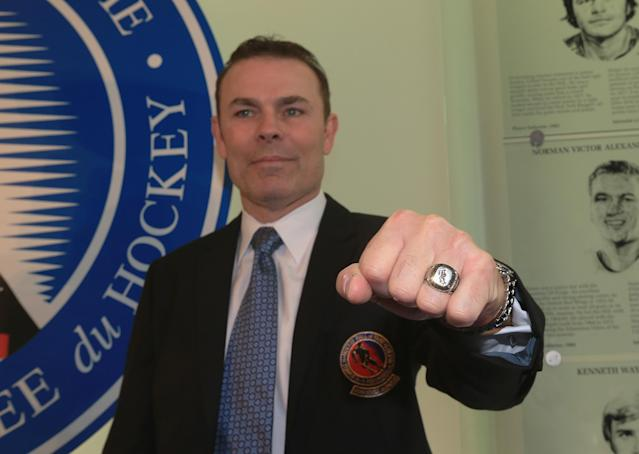 TORONTO, ON - NOVEMBER 12: Adam Oates poses with his Hall of Fame ring at the Hockey Hall of Fame ring ceremony on November 12, 2012 in Toronto, Canada. Oates and three other former NHL players will be inducted into the Hall during a ceremony later today. (Photo by Bruce Bennett/Getty Images)