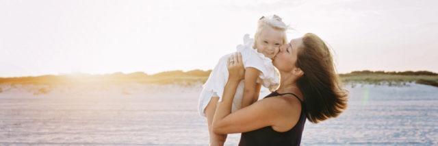 Farah with her child on the beach.