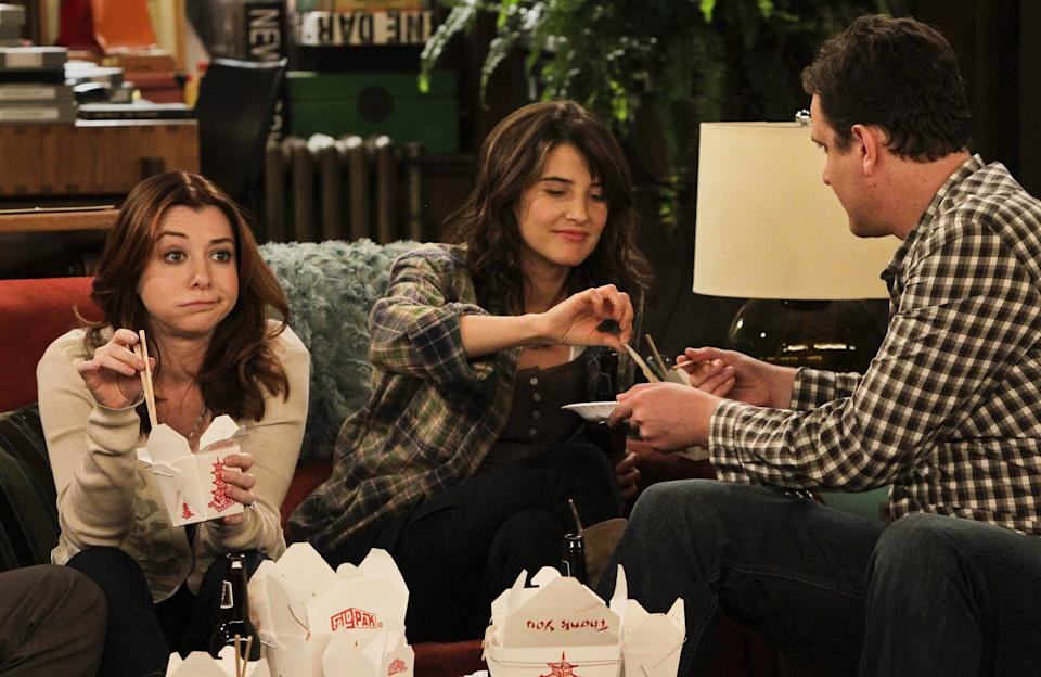 L to R Alyson Hannigan (lily), Cobie Smulders (Robin) and Jason Segel (Marshall) hang out in the apartment during the filming on the set of the sitcom, How I Met Your Mother, on the Fox lot in Century City on November 11, 2010. For story on babies in sitcoms. Lily and Marshall are married on the show.  (Photo by Anne Cusack/Los Angeles Times via Getty Images)