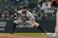 San Francisco Giants first baseman Brandon Belt catches the throw for the out on a grounder by Seattle Mariners' J.P. Crawford during the fourth inning of a baseball game Saturday, April 3, 2021, in Seattle. (AP Photo/Ted S. Warren)