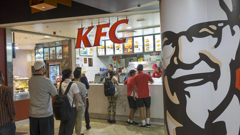 Customers queue at KFC which closes dining rooms in Australia as COVID-19 prevention measure