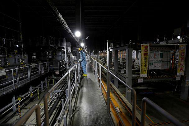 PHOTO: In this Feb. 18, 2019, file photo, an employee of Tokyo Electric Power Co (TEPCO) is shown wearing a protective suit and mask inside a radiation filtering Advanced Liquid Processing Systems at tsunami-crippled Fukushima Daiichi nuclear power plant. (Issei Kato/Reuters, FILE)