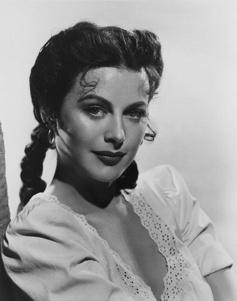 <p>Known for her straight down the middle part, Austrian actress Hedy Lamarr often styled her hair in French braids with volume on the sides and curled tendrils on the front. </p>
