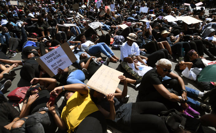 Demonstrators protest against gender based violence in Sandton, Johannesburg Friday, Sept. 13, 2019. The protesters are calling on President Cyril Ramaphosa to declare a state of emergency, a day after the country's latest crime statistics were released. (AP Photo)