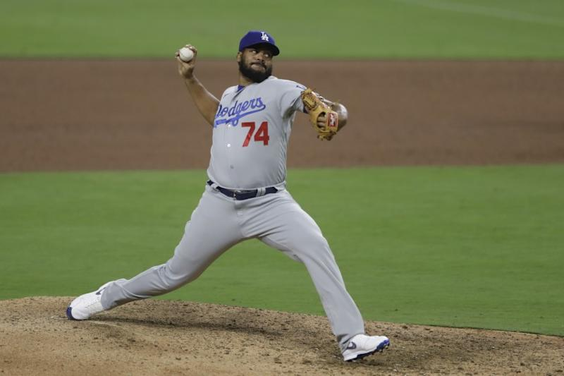 Los Angeles Dodgers relief pitcher Kenley Jansen works against a San Diego Padres batter during the ninth inning of a baseball game Tuesday, Aug. 4, 2020, in San Diego. (AP Photo/Gregory Bull)