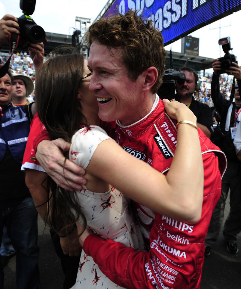 INDIANAPOLIS, IN - MAY 25:  Scott Dixon of New Zealand, driver of the #9 Target Chip Ganassi Dallara Honda, celebrates with his wife Emma Dixon after winning the pit stop challenge on Carb Day for the Indianapolis 500 on May 25, 2012 at the Indianapolis Motor Speedway in Indianapolis, Indiana.  (Photo by Robert Laberge/Getty Images)