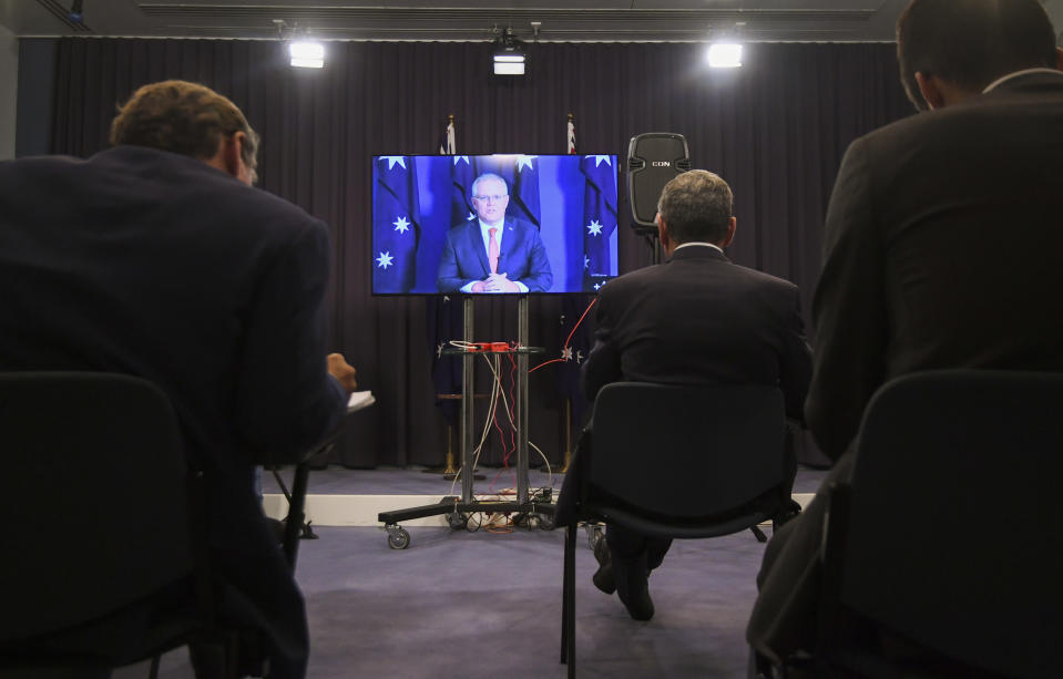 """Australian Prime Minister Scott Morrison speaks to the media during a virtual press conference at Parliament House in Canberra, Thursday, Nov. 26, 2020. Morrison said he's """"thrilled and relieved"""" after Iran released in a prisoner swap a 33-year-old academic who was imprisoned for more than two years on spying charges, but added it would take time for Kylie Moore-Gilbert to process her """"horrible"""" ordeal. (Lukas Coch/AAP Image via AP)"""