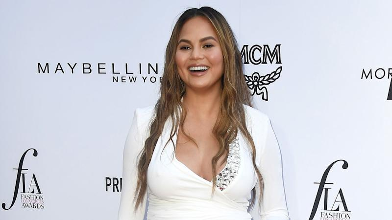 Chrissy Teigen Shares Adorable Photo Of Luna Giving Brother Miles a Pacifier