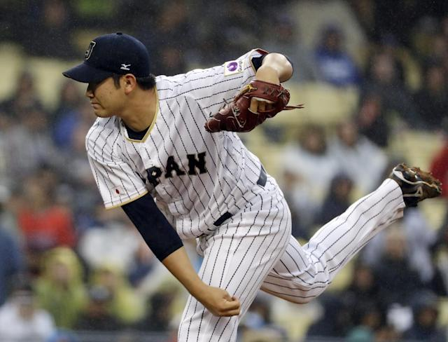 <p>Japan's Tomoyuki Sugano throws during the first inning of a semifinal in the World Baseball Classic against the United States in Los Angeles, Tuesday, March 21, 2017. (AP Photo/Chris Carlson) </p>