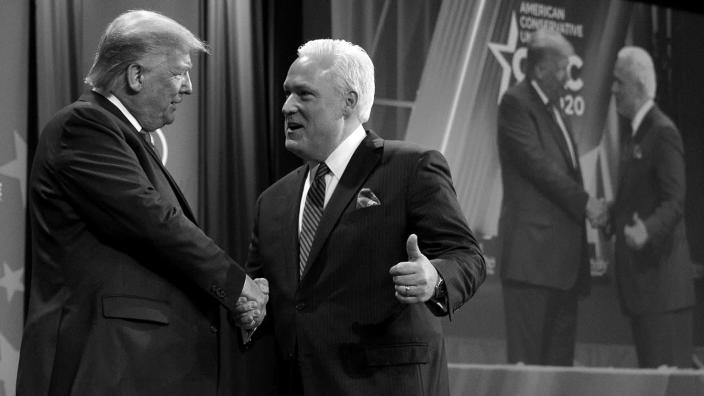 President Trump is greeted by Matt Schlapp, chairman of the American Conservative Union, at the Conservative Political Action Conference on Feb. 29. (Jacquelyn Martin/AP)