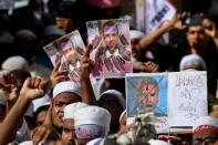 Muslims take part in a protest in Dhaka