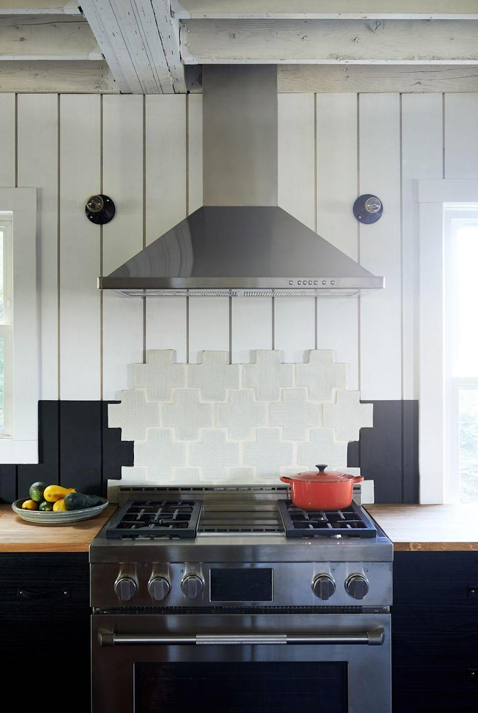 <p>If you can't make up your mind, who says you can't have it all? Layering color-blocked wood panels with tiles, you'll achieve an intriguing three dimensional look. Stick to neutral tones if you don't want it too appear chaotic. </p>