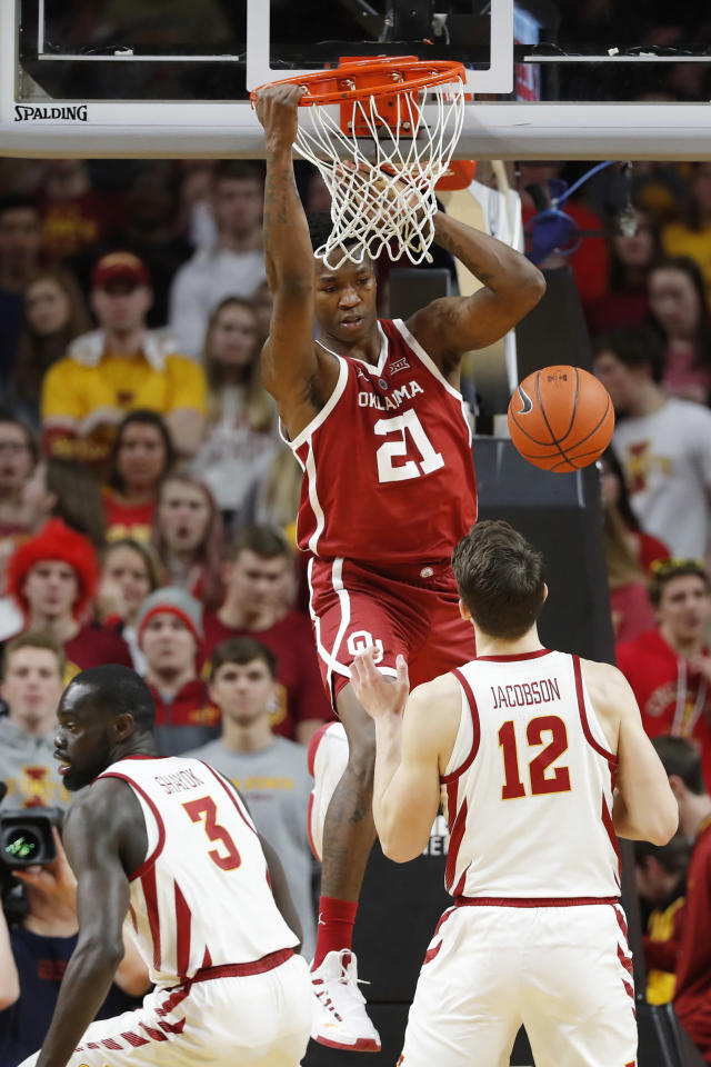 Oklahoma forward Kristian Doolittle (21) dunks the ball over Iowa State's Marial Shayok (3) and Michael Jacobson (12) during the second half of an NCAA college basketball game, Monday, Feb. 25, 2019, in Ames, Iowa. (AP Photo/Charlie Neibergall)