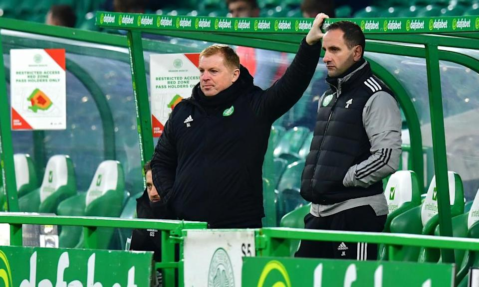 Neil Lennon (left) looks on as Celtic lose 2-0 at home to Ross County in the League Cup on 29 November.