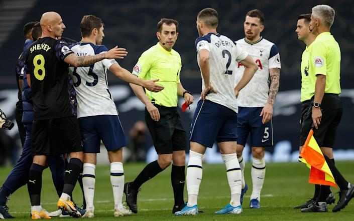 Peter Bankes gives a red card to Tottenham goalkeeping coach Nuno Santos. - Eddie Keogh Telegraph Media Group