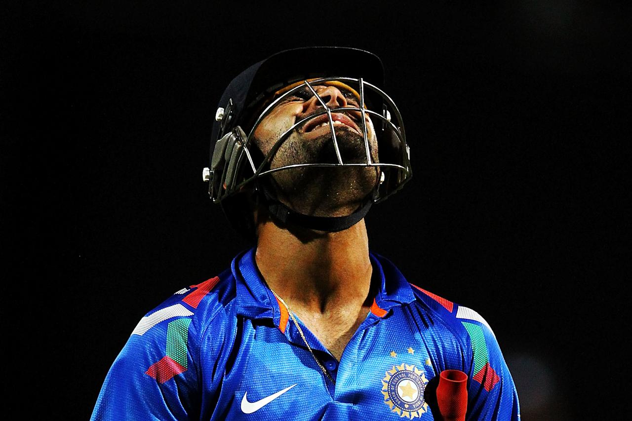 HAMILTON, NEW ZEALAND - JANUARY 22:  Virat Kohli of India reacts as he leaves the field after being dismissed by Tim Southee of New Zealand during the One Day International match between New Zealand and India at Seddon Park on January 22, 2014 in Hamilton, New Zealand.  (Photo by Anthony Au-Yeung/Getty Images)