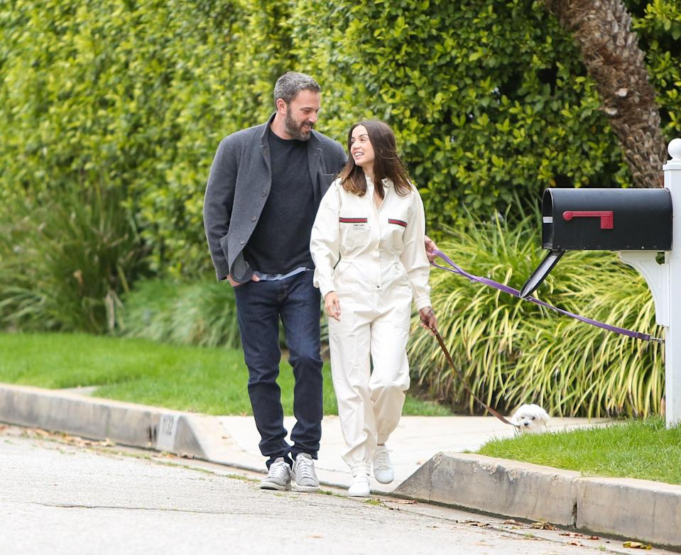 """<p>Perhaps the <a href=""""https://www.glamour.com/story/ben-affleck-and-ana-de-armas-a-complete-relationship-timeline?mbid=synd_yahoo_rss"""" rel=""""nofollow noopener"""" target=""""_blank"""" data-ylk=""""slk:most famous quarantine couple"""" class=""""link rapid-noclick-resp"""">most famous quarantine couple</a> has called it quits after about <a href=""""https://www.glamour.com/story/ben-affleck-and-ana-de-armas-a-complete-relationship-timeline?mbid=synd_yahoo_rss"""" rel=""""nofollow noopener"""" target=""""_blank"""" data-ylk=""""slk:one year of dating"""" class=""""link rapid-noclick-resp"""">one year of dating</a>, according to sources who spoke with <a href=""""https://people.com/movies/ben-affleck-and-ana-de-armas-split-source/"""" rel=""""nofollow noopener"""" target=""""_blank"""" data-ylk=""""slk:People"""" class=""""link rapid-noclick-resp""""><em>People</em></a> on January 18. """"Ben is no longer dating Ana. She broke it off,"""" one source said. """"Their relationship was complicated. Ana doesn't want to be Los Angeles based and Ben obviously has to since his kids live in Los Angeles.""""</p> <p>However, another source claims the split was """"mutual and something that is completely amicable."""" They told <em>People</em>, """"They are in different points in their lives; there is deep love and respect there. Ben continues to want to work on himself. He has three jobs lined up and he's a solid father at home. They are both happy with where they are in their lives.""""</p> <p>Though photos of the couple <a href=""""https://www.glamour.com/story/ben-affleck-and-ana-de-armas-a-complete-relationship-timeline?mbid=synd_yahoo_rss"""" rel=""""nofollow noopener"""" target=""""_blank"""" data-ylk=""""slk:getting cozy in lockdown"""" class=""""link rapid-noclick-resp"""">getting cozy in lockdown</a> began surfacing in March 2020, the relationship was confirmed when de Armas <a href=""""https://www.glamour.com/story/ana-de-armas-selfie-with-ben-affleck?mbid=synd_yahoo_rss"""" rel=""""nofollow noopener"""" target=""""_blank"""" data-ylk=""""slk:posted a selfie"""" class=""""link rapid-noclick-resp"""">posted a selfie</a> with her <"""