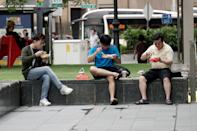 People seen eating at Raffles Place Park on 7 April 2020, the first day of Singapore's month-long circuit breaker period. (PHOTO: Dhany Osman / Yahoo News Singapore)