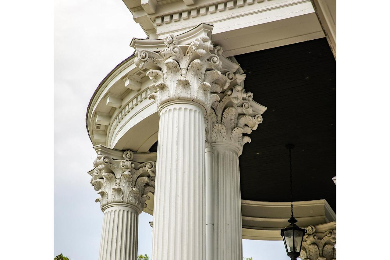 <p>Stunning Corinthian columns support the home's giant portico.</p>