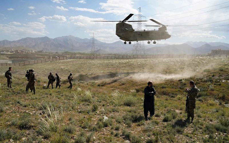 US forces with Nato colleagues in Afghanistan last year - GETTY IMAGES