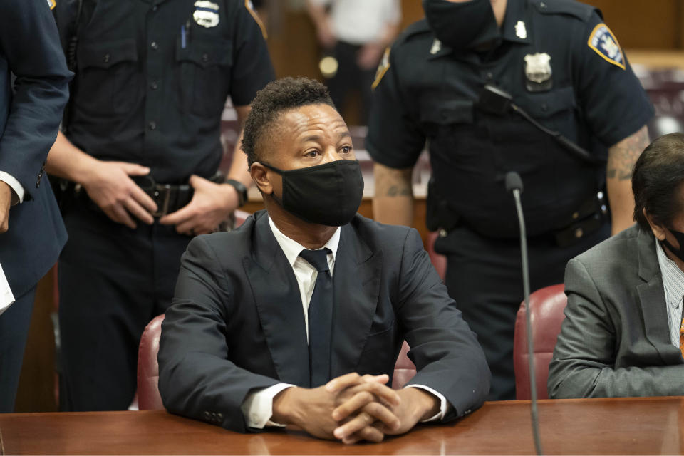 Actor Cuba Gooding Jr. sits in court during a hearing in his sexual misconduct case, Thursday, Aug. 13, 2020, in New York. A judge ordered the courtroom outfitted with Plexiglas and other measures to prevent the spread of the coronavirus, which has delayed the trial indefinitely. (Steven Hirsch/New York Post via AP, Pool)